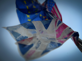 British, European and US flags flutter in the wind in Vigo