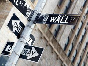 A Wall Street sign hangs near the New York Stock Exchange