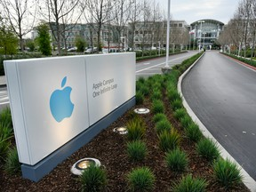 Signage is displayed at the entrance of Apple Inc. headquarters