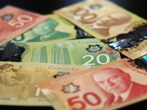 A new survey says 56 per cent of Canadians are just $200 or less per month away from being unable to meet their debts.