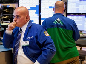 U.S. stock futures are treading water and Canadian stocks look headed for a lower open as investors remained cautious after a broad selloff a day yesterday.