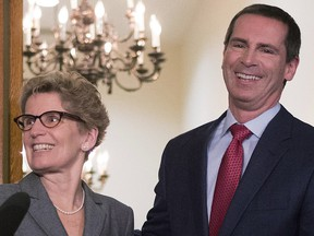 Dalton McGuinty (right) and Kathleen Wynne pose for media after a meeting at Queen's Park in Toronto on January 28, 2013.