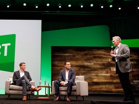 Gold medalist Michael Phelps, left, inspires attendees during a fireside chat with entrepreneur Bill Rancic and Intuit CEO Brad Smith at the third annual QuickBooks Connect on Tuesday, Oct. 25, 2016 in San Jose, Calif.