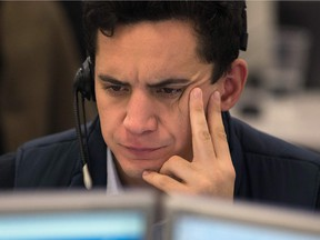A trader from ETX Capital works in London following the result of the US presidential election.
