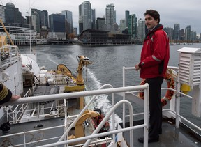 Prime Minister Justin Trudeau stands on board the Canadian Coast Guard ship Sir Wilfrid Laurier, during a tour of the harbour in Vancouver, B.C., on Monday. Following the tour, Trudeau announced a new oceans' protection initiative funded by the federal government.