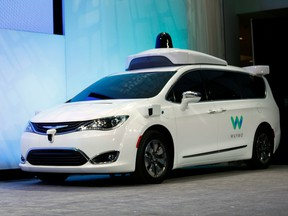 A customized Chrysler Pacifica Hybrid that will be used for Google's autonomous vehicle program on stage at the 2017 North American International Auto Show
