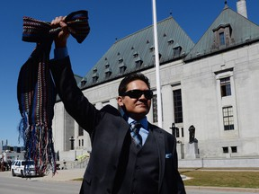"""Gabriel Daniels, son of the late Harry Daniels, reacts as he leaves the Supreme Court of Canada in Ottawa on Thursday, April 14, 2016, following their unanimously ruling that Metis and non-status are Indians under the Constitution. The Congress of Aboriginal Peoples joined with several individuals, including Metis leader Harry Daniels, in taking the federal government to court in 1999 to allege discrimination because they were not considered """"Indians"""" under the Constitution."""