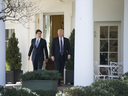 U.S. President Donald Trump, right, speaks with Justin Trudeau, Canada's prime minister, while leaving the Oval Office of the White House