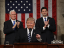 U.S. VP Mike Pence, left, and House Speaker  Paul Ryan applaud as U.S. President Donald Trump arrives to deliver his first address to a joint session of the U.S. Congress