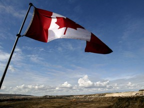 A Canadian flag waves over Alberta's oilsands.