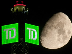 The Moon is seen beyond a Toronto-Dominion Bank (TD) logo displayed atop the TD Canada Trust Tower in the financial district of Toronto, Ontario, Canada, on Aug. 29, 2009.