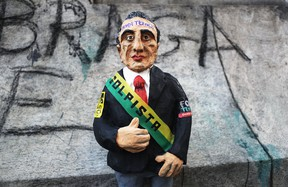 A doll portraying President Michel Temer is displayed at a protest against the government's proposed pension reforms and other austerity measures on May 1, 2017 in Rio de Janeiro, Brazil.