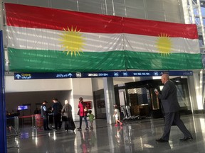 A Kurdish flag hangs in the Irbil International Airport, in Iraq, Wednesday, Sept. 27, 2017. Iraq's prime minister ordered the country's Kurdish region to hand over control of its airports to federal authorities or face a flight ban, a response to the Kurdish independence referendum. (AP Photo/Khalid Mohammed)