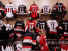 """Fans of NHL player Daniel Alfredsson buy jerseys at a Canadian Tire in Ottawa. """"Canadian Tire has the best retail locations in Canada among the general merchandisers, due to its long-standing presence in the country,"""" said a BMO analyst of the chain's ongoing retail success."""