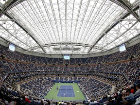 """FILE- In this Sept. 6, 2017 file photo, fans fill the stands at Arthur Ashe stadium as Karolina Pliskova, of Czech Republic, plays CoCo Vandeweghe, of the United States, during the quarterfinals of the U.S. Open tennis tournament in New York. The arrest of an Estonian man for trespassing at the US Open has renewed questions about """"courtsiding,"""" the surreptitious collection of data for gamblers using online exchanges to bet point-by-point on tennis matches. (AP Photo/Adam Hunger, File)"""
