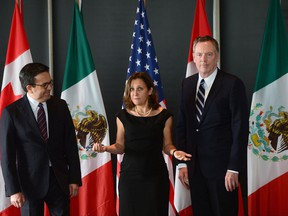 Minister of Foreign Affairs Chrystia Freeland meets for a trilateral meeting with Mexico's Secretary of Economy Ildefonso Guajardo Villarreal, left, and Ambassador Robert E. Lighthizer, United States Trade Representative, during the final day of the third round of NAFTA negotiations in Ottawa.