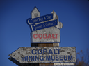 A sign for the Cobalt Mining Museum is displayed in Cobalt, Ont. Global demand forcobalt, a component in batteries used to power electric cars for automakers fromTesla Inc.to Volkswagen AG, is changing the importance of the metal. Cobalt, both the town and the metal, are also attracting renewed attention as a buffer to rising political risks in the Democratic Republic of Congo.
