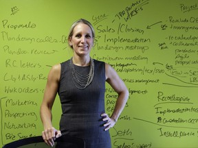 In this Wednesday, Oct. 4, 2017, photo, Kirsten Curry, owner of Leading Retirement Solutions, poses for a portrait in her office in Seattle. Curry has applied to four banks for loans for the retirement planning advisory firm and been turned down by three. Curry isn't optimistic about an approval from the fourth bank, so she and her finance manager are working with a referral program to link them up with other banks. (AP Photo/Elaine Thompson)