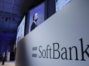 FILE - In this July 20, 2017, file photo, SoftBank Group Corp. Chief Executive Officer Masayoshi Son, left, speaks during a SoftBank World presentation at a hotel in Tokyo. Japanese technology conglomerate SoftBank has reached a deal with Uber to invest billions in the ride-hailing giant. Uber Technologies Inc. confirmed the investment in a statement Sunday, Nov. 12, without giving details. (AP Photo/Shizuo Kambayashi, File)
