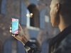 The OnePlus 5T being held by a user.