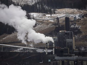 A coal mining operation in Sparwood, B.C. Canada's national pension fund manager is among a group of Canadian companies who are undermining the federal government's international anti-coal alliance by investing in new coal power plants overseas, an environmental organization says.
