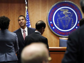 Federal Communications Commission (FCC) Chairman Ajit Pai, left, greets witnesses before a meeting where the FCC will vote on net neutrality, Thursday, Dec. 14, 2017, in Washington.