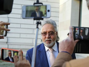 F1 Force India team boss Vijay Mallya arrives at Westminster Magistrates Court in London, Thursday, Dec. 14, 2017. Mallya, the United Breweries Group chairman and co-owner of the Force India F1 team is wanted in India to face fraud allegations. He was arrested in April by the Metropolitan Police's extradition unit on behalf of authorities in India.