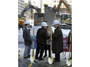 Quicken Loans founder Dan Gilbert, center, meets with Joe Hudson, former CEO of the J.L. Hudson Company at the groundbreaking site of the city's new 800-foot-tall building, Thursday, Dec. 14, 2017, in Detroit. Bedrock Detroit real estate says the $900 million two-building project will include a 58-story residential tower and 12-floor building for retail and conference space. The tower will have an 800-foot-tall (244-meter) sky deck.