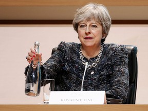 British Prime Minister Theresa May attends the plenary session of One Planet Summit, in Boulogne-Billancourt near Paris, France, Tuesday, Dec. 12, 2017. World leaders, investment funds and energy magnates promised to devote new money and technology to slow global warming at a summit in Paris that President Emmanuel Macron hopes will rev up the Paris climate accord that U.S. President Donald Trump has rejected.