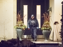 A Toronto police officer leaves the home of Honey and Barry Sherman who were found dead there, Friday Dec. 15, 2017.