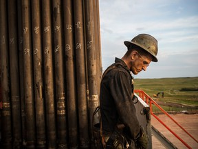 Ray Gerish, a floor hand for Raven Drilling, works on an oil rig drilling into the Bakken shale formation in North Dakota. Canada is looking to its own shale fields to repair the economic damage caused by a surge in U.S. oil.