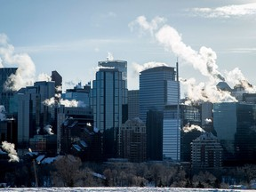 Exhaust plumes from buildings in downtown Calgary on Jan. 2, 2017. The province was on its second day of its new carbon tax.