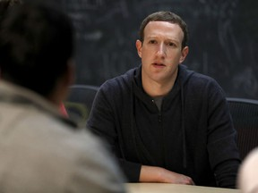 File-This Nov. 9, 2017, file photo shows Facebook CEO Mark Zuckerberg meeting with a group of entrepreneurs and innovators during a round-table discussion at Cortex Innovation Community technology hub  in St. Louis. Facebook is announcing its second major tweak to its algorithm this month, saying it will prioritize news based on users' votes. The company said in a blog post and Facebook post from Zuckerberg Friday, jan. 19, 2018,  that it will survey users about how familiar they are with a news source and if they trust it.