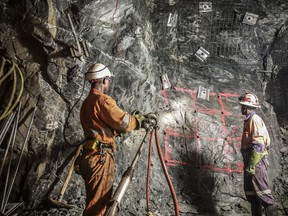 Mine workers are shown in a handout photo from Acacia Mining.