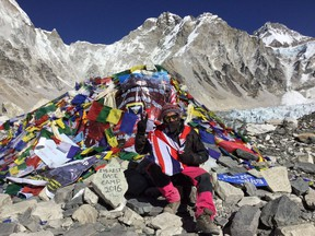 """Two years ago James Fletcher departed Toronto for a year-long adventure to 21 countries, where he mountain biked down Bolivia's """"death road"""", watched a cricket match in India and learned to surf in Nicaragua -- and he did it all for about $25,000. James Fletcher poses at a Mount Everest Base camp in Nepal in an undated handout photo."""
