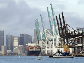 A container ship is docked at the Port of Miami, Monday, Feb. 5, 2018, in Miami Beach, Fla. The Commerce Department reports on the U.S. trade gap for December, on Tuesday, Feb. 6.