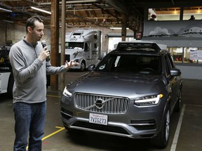 FILE - In this photo taken Tuesday, Dec. 13, 2016, file photo, Anthony Levandowski, then-head of Uber's self-driving program, speaks about their driverless car in San Francisco. A Google-bred pioneer in self-driving cars will collide with Uber's beleaguered ride-hailing service in a courtroom showdown Monday, Feb. 4, 2018, revolving around allegations of deceit, betrayal, espionage and a high-tech heist that tore apart one-time allies.
