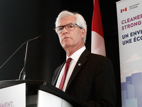 Natural Resources Minister Jim Carr announces a new project assessment process at a press conference in Calgary on Feb. 8, 2018.
