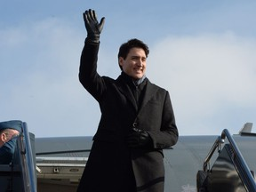 Prime Minister Justin Trudeau waves as arrives in Chicago, on Wednesday, February 7, 2018.