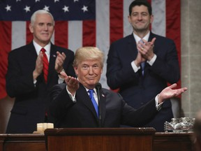 """FILE - In this Jan. 30, 2018, file photo, President Donald Trump gestures as delivers his first State of the Union address in the House chamber of the U.S. Capitol to a joint session of Congress in Washington, as Vice President Mike Pence and House Speaker Paul Ryan applaud. Less than a week ago, Trump stood before the nation and called for a new era of bipartisan cooperation. """"Tonight, I call upon all of us to set aside our differences, to seek out common ground, and to summon the unity we need to deliver for the people we were elected to serve,"""" he said, extolling how the country had come together in recent times of tragedy. A week later, such talk is but a distant memory."""