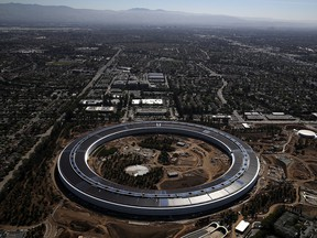 """Apple's new """"spaceship"""" campus boasts a huge glass-walled building that has caused some injuries among staff."""