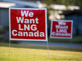 """Signs reading """"We Want LNG Canada"""" stand on a lawn in the residential area of Kitimat, B.C. LNG Canada's export terminal would be built in the community if the project gets the okay."""
