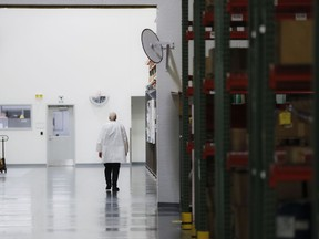 In this Oct. 24, 2017, photo, an employee walks off the manufacturing floor while wearing his laboratory coat at Lord Corporation, a manufacturer of industrial coatings, adhesives, bearings, and sensing equipment for range of commercial markets, including United States military contracts in Erie, Pa. Since 2008, Erie has suffered a hidden and potentially more devastating exodus: The loss of well-paid white-collar jobs. The city has shed 8 percent of its accountants, 10 percent of its computer workers, 40 percent of its engineers and 20 percent of its lawyers, according to government occupational data analyzed by The Associated Press.