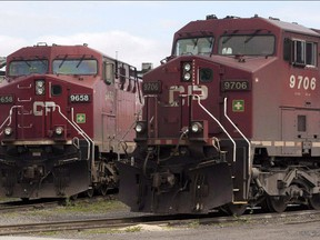 Canadian Pacific Railway locomotives sit in a rail yard.