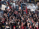 Thousands of people march together during a protest against the Kinder Morgan Trans Mountain pipeline expansion in Burnaby, B.C., on March 10.