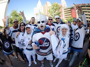Winnipeg Jets fans cheer on their team outside T-Mobile Arena before the Jets face the Vegas Golden Knights during Western Conference Finals, game 3, in Las Vegas, Wednesday, May 16, 2018.