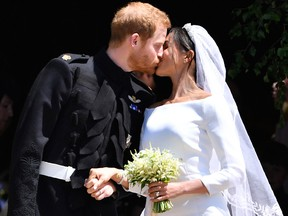 Britain's Prince Harry and his wife Meghan Markle kiss after their wedding ceremony at St. George's Chapel in Windsor Castle in Windsor, near London, England, Saturday, May 19, 2018.