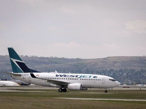 WestJet planes are seen at the Calgary Airport in Calgary, Alta., Thursday, May 10, 2018. WestJet Airlines says contract negotiations with its pilots resumed Monday in Calgary. Talks between the airline and pilots represented by the Air Line Pilots Association moved from Halifax where they took place last week.