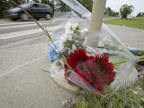 A roadside memorial marks where a pedestrian died. Such deaths have been rising in Canada.
