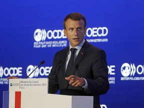 """French President Emmanuel Macron delivers a speech at the OECD ministerial council meeting on """"Refounding Multilateralism"""" in Paris, France, Wednesday, May 30, 2018. Macron warned against trade wars in an impassioned speech about international cooperation Wednesday, two days before the Trump administration decides whether to hit Europe with punishing new tariffs."""